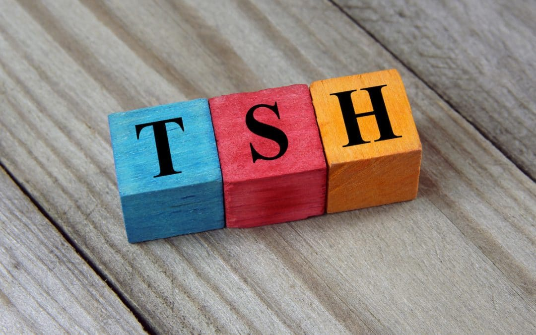 TSH (Thyroid-stimulating hormone) symbol on colorful wooden cubes